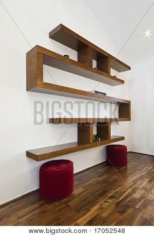 detail of a modern luxury designer hard wood book shelf