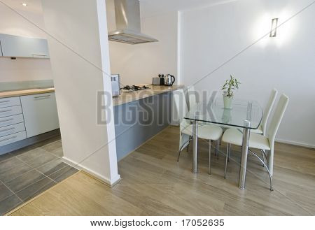 modern open plan kitchen with separate work zones and dining table