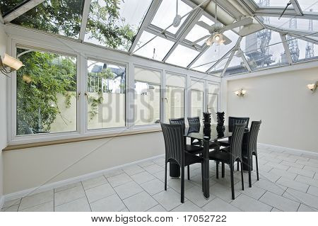 double glazed atrium with modern dining table
