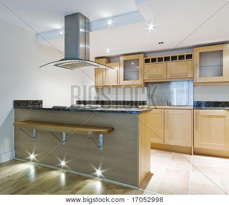 modern kitchen isle with breakfast bar and designer elements