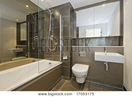 luxury bathroom with white suite and dark brown ceramic tiles