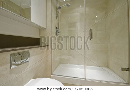 modern en-suite bathroom with floor to ceiling marble tiles