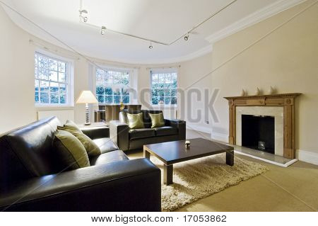 massive living room with bay window and contemporary furniture