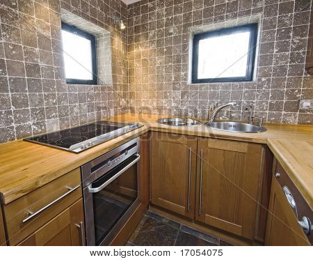 modern hard wood kitchen unit with stone tiles