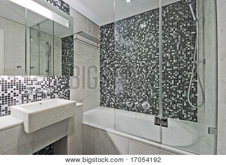 modern luxury bathroom with large bath tub and mosaic tiles