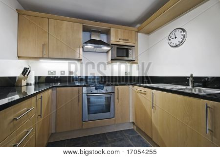 modern kitchen counter with hard wood finish and granite worktop