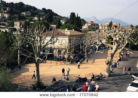 men playing petanque on the main place of the typical south east of france old stone village of saint paul de vence on the french riviera refuge of many artist,painters,sculptors