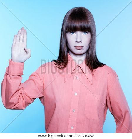 studio portrait of a young woman on isolated background gesturing sto