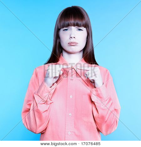 studio portrait of a young woman on isolated background gesturing