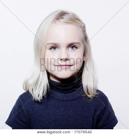 studio portrait of a caucasian cute litle girl