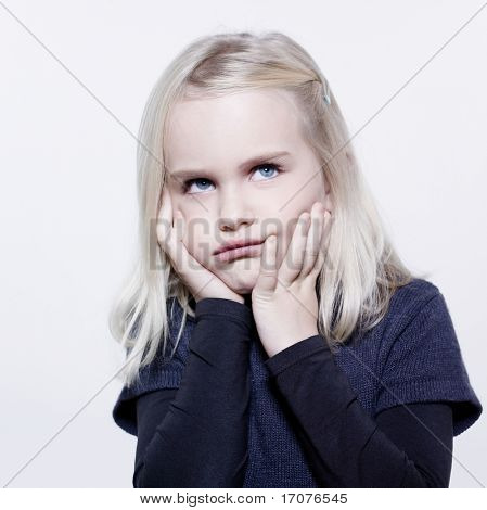 studio portrait of a caucasian cute sulk litle girl