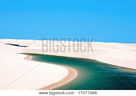 view of lagoa azul in desert white sand dunes of the Lencois Maranheses National Park in brazil