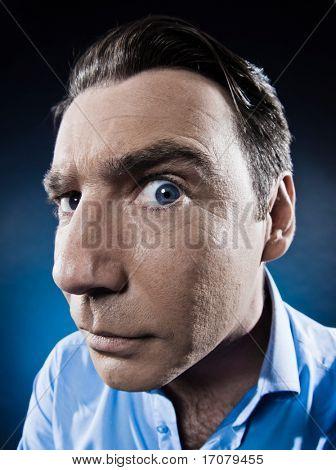 caucasian man observe suspicious  portrait isolated studio on black background