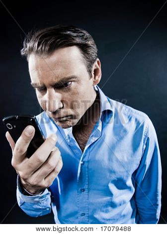 caucasian man angry with cellphone malfunction portrait isolated studio on black background