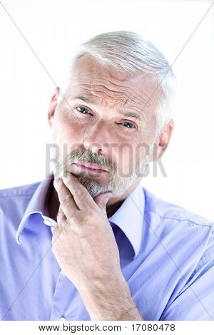 caucasian senior man portrait puckering distrust isolated studio on white background