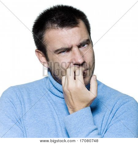 studio portrait on isolated background of a stubble man biting nails anxious nervous
