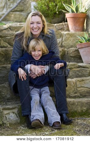 A mother and her young son having fun in the garden