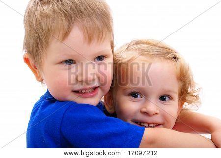 Cheerful children embrace