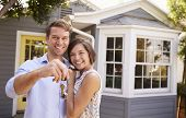 Couple With Keys Standing Outside New Home poster