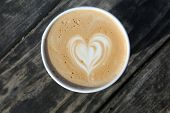 latte. latte with a heart design. paper coffee cup. breast cancer awareness. coffee  poster