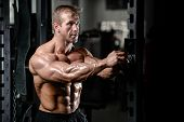 Brutal Strong Bodybuilder Man Pumping Up Muscles And Train Gym poster