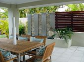 stock photo of pergola  - Stylish outdoor living space under the cover of a pergola - JPG