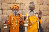 stock photo of jain  - jain priest welcoming saluting in jaisalmer in rajasthan state in india - JPG