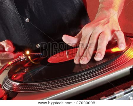 Working Disc jockey at party. Detail of a disc jockey  hands.