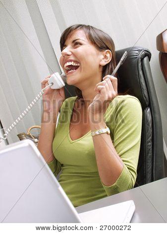 Optimist hispanic businesswoman working at office.