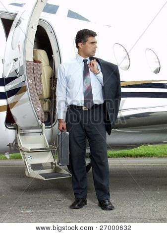 Businessman outside his private plane.