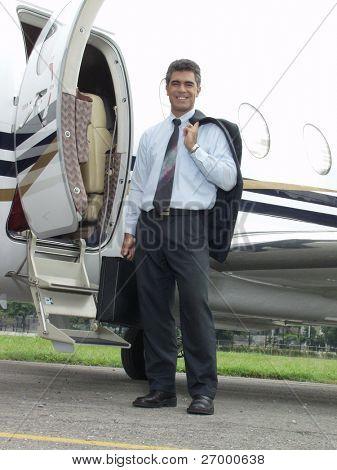 Businessman outside his private plane.