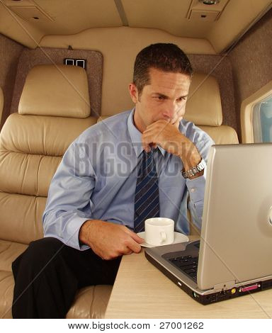 Business man working at private jet.