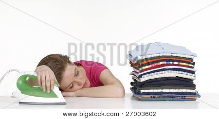 Young woman resting after ironing.