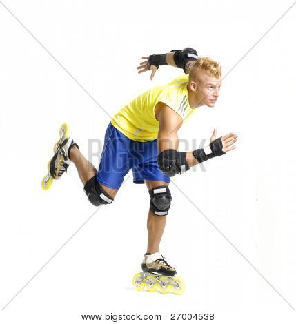 Sportive young man skating on white background.