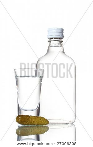 Bottle of vodka and wineglass with cucumber isolated on white