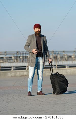 poster of Carry Travel Bag. Business Trip. Man Bearded Hipster Travel With Big Luggage Bag On Wheels. Let Trav