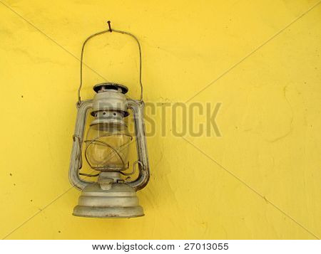 Old lantern vintage hanging on yellow wall
