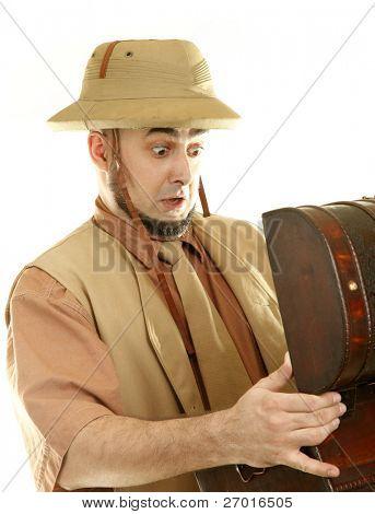 Adventurer explorer with open treasure chest