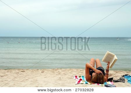 Bikini Girl Reading book in relax mood on the Tropical beach, Samui Thailand