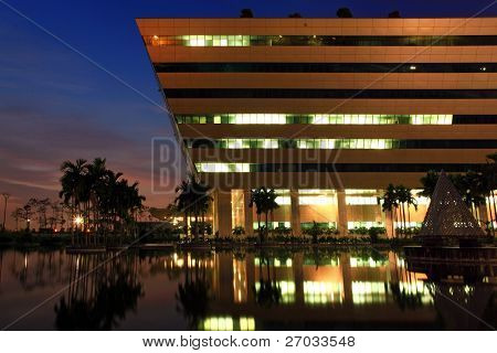 BANGKOK - DEC 20 : part of Government Complex shines at Dusk in Bangkok Thailand on Dec 20.2010 in Bangkok. Government Complex has 34 government units located at Chaeng Wattana St. in Bangkok.