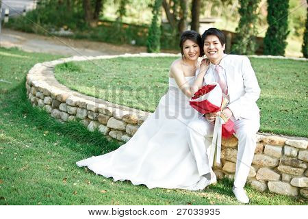 couples of bride and groom on green meadows