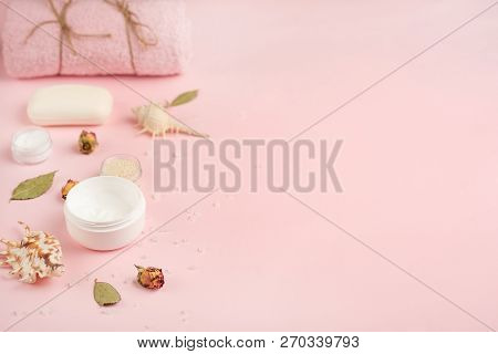 poster of Beautiful Spa Composition In The Wellness Center On A Pink Background, Towels, Bath Salt, Aroma Stic