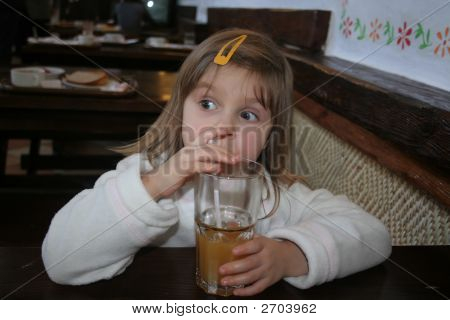 Thinking Girl Drinking Fruit Juice