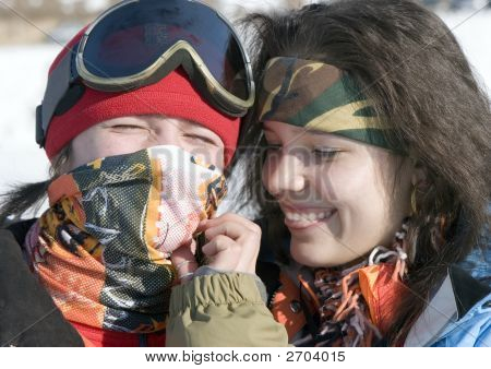 A Lifestyle Image Of Two Young Adult (Age 18-20) Snowboarders