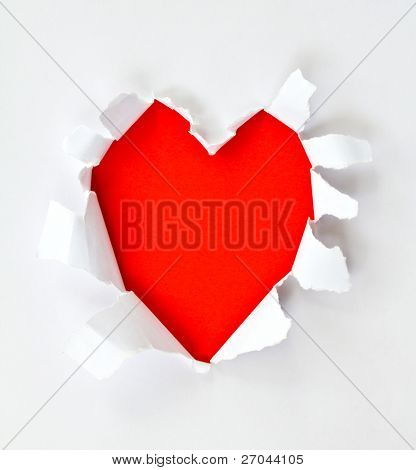 Sheet of paper with a Heart shape hole against bright red background isolated on white