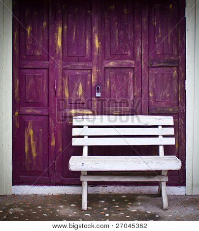 Old chair  in front of old door