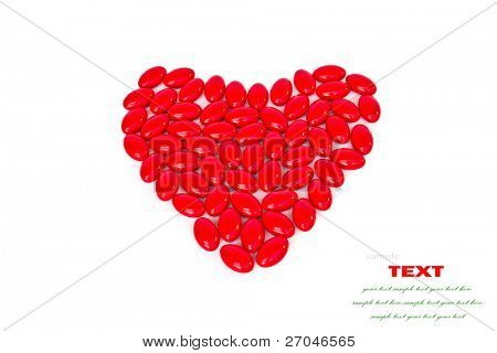 Red medicinal pills heart shape  on a white background  with space for text