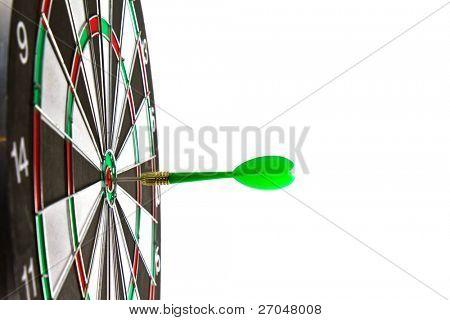 Dartboard with dart on white background.