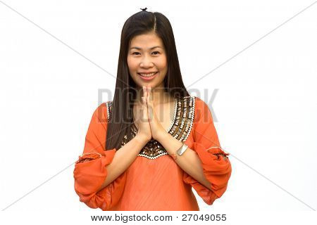Closeup portrait of a young woman praying against white background