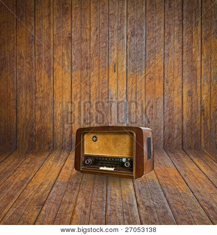 Old room with wooden floor and vintage radio